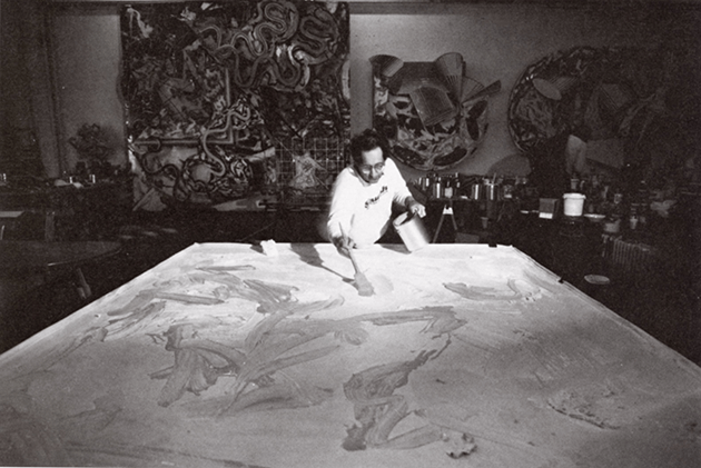 Stella in his studio at work on a piece from the Cones and Pillars series.