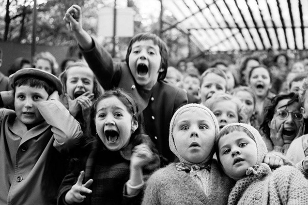 """Children watched the story of """"Saint George and the Dragon"""" at an outdoor puppet theater in Paris, 1963. Alfred Eisenstaedt/Life Pictures/Getty Images"""