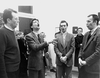 "Opening of Martin Kippenberger and Albert Oehlen's show Women in My Father's Life in the Erhard Klein Gallery, Bonn, 1983. Featuring Max Hetzler, Werner Büttner, Albert Oehlen and Martin Kippenberger, singing the miner's song ""Glück auf, Glück auf"". © Galerie Klein."
