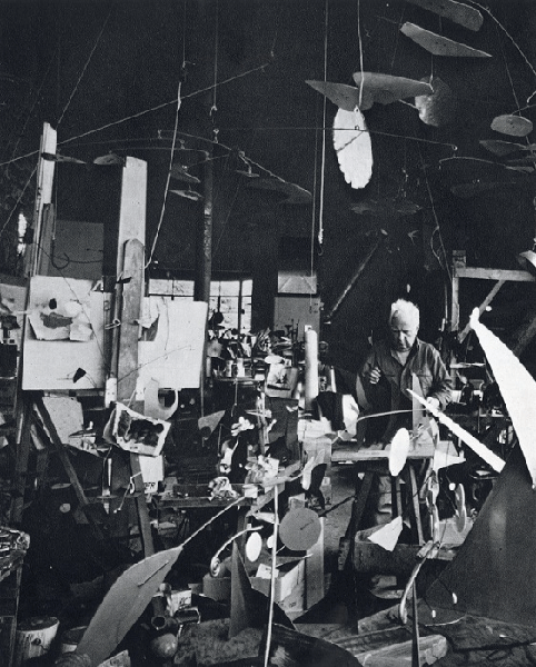 Alexander Calder in his studio. Artwork © 2020 Calder Foundation, New York/Artists Rights Society (ARS), New York
