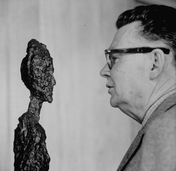 Art collector G. David Thompson examining a sculpture by Alberto Giacometti. Image:  Yale Joel/The LIFE Picture Collection via Getty Images. © The Estate of Alberto Giacometti (Fondation Giacometti, Paris and ADAGP, Paris), licensed in the UK by ACS and DACS, London 2021.