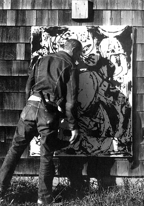 Jackson Pollock at work on the 'black paintings' (Number 8), 1950. Photograph by Hans Namuth. Courtesy Center for Creative Photography, University of Arizona © 1991 Hans Namuth Estate.