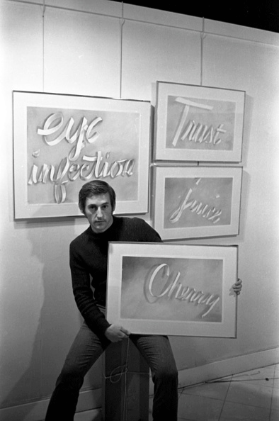 Portrait of Edward Ruscha as he poses with several of his 'Gunpowder Ribbon Drawings', New York, 9 December, 1967.  Image: Getty Images. © Ed Ruscha.