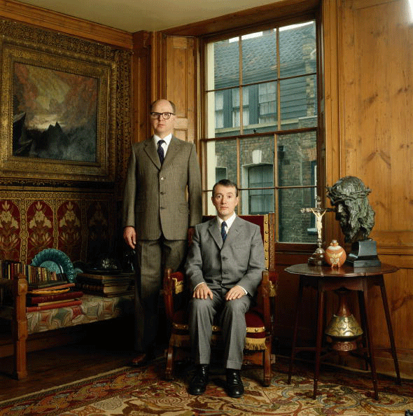Gilbert and George at their home in Fournier Street, Spitalfields, East London, circa 1990. Image: David Montgomery/Getty Images.
