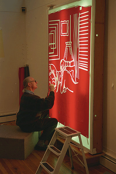 Roy Lichtenstein using a light box to cut a Rubylith stencil for his color relief print Roommates, from the Nudes Series, Tyler Graphics Ltd. artist' studio, Mount Kisco, New York, 1994. Photograph by Kenneth Tyler.