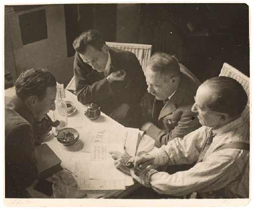 André Kertész's In Mondrian's Studio, 1926 shows Belgian painter, writer, and critic Marcel Seuphor; Juozas Tysliava; Louis Saalborn; and Mondrian (not in sale)