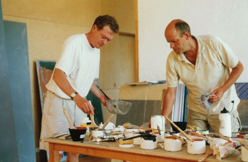 Gunther Forg in his studio with friend.