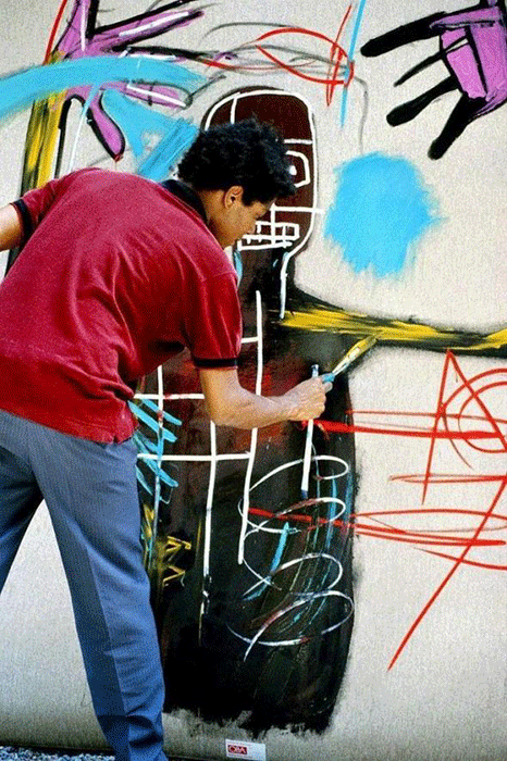 Jean-Michel Basquiat in 1983, working on a painting in St Moritz, Switzerland. Photograph by Lee Jaffe/Getty Images.