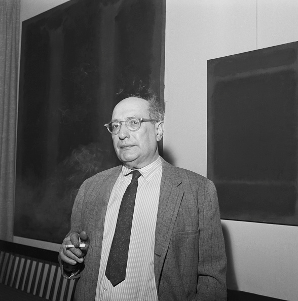 Mark Rothko in his New York apartment standing before two of his paintings, 28 January 1967, New York. © 2021 Kate Rothko Prizel & Christopher Rothko ARS, NY and DACS, London.