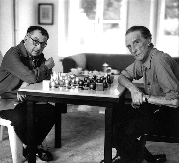 Man Ray and Marcel Duchamp playing chess, c. 1957. © Michel Sima / Bridgeman Images