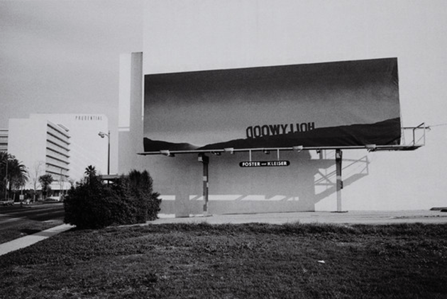 """Lloyd Ziff, Edward Ruscha's """"The Back of Hollywood"""" Billboard, Wilshire Blvd., The Miracle Mile, Los Angeles, CA, 1978, printed 2015. Purchased with funds provided by Lynda and Robert Shapiro (M.2016.105.2) © Lloyd Ziff. Digital Image © 2021 Museum Associates / LACMA. Licensed by Art Resource, NY"""